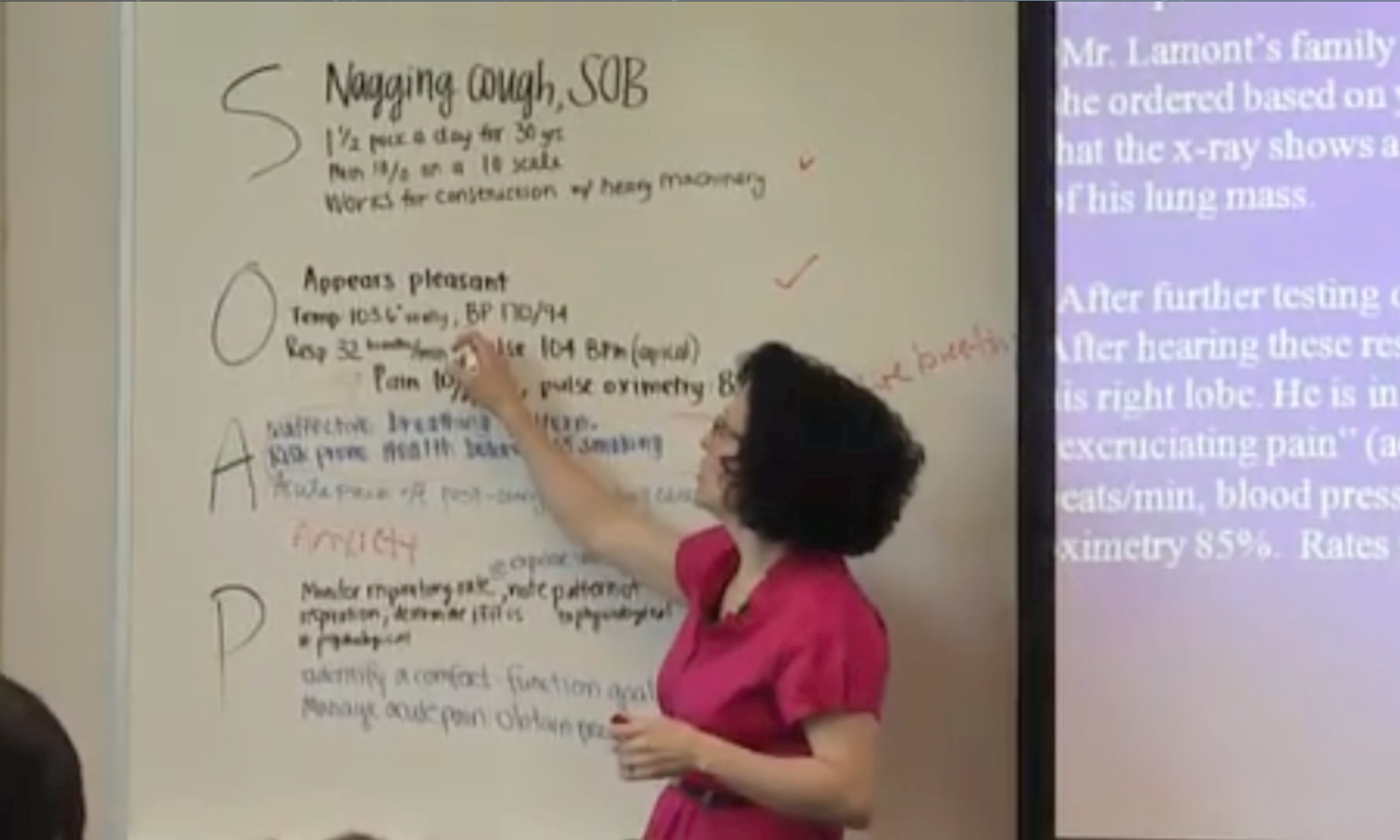 Teacher in front of a white board