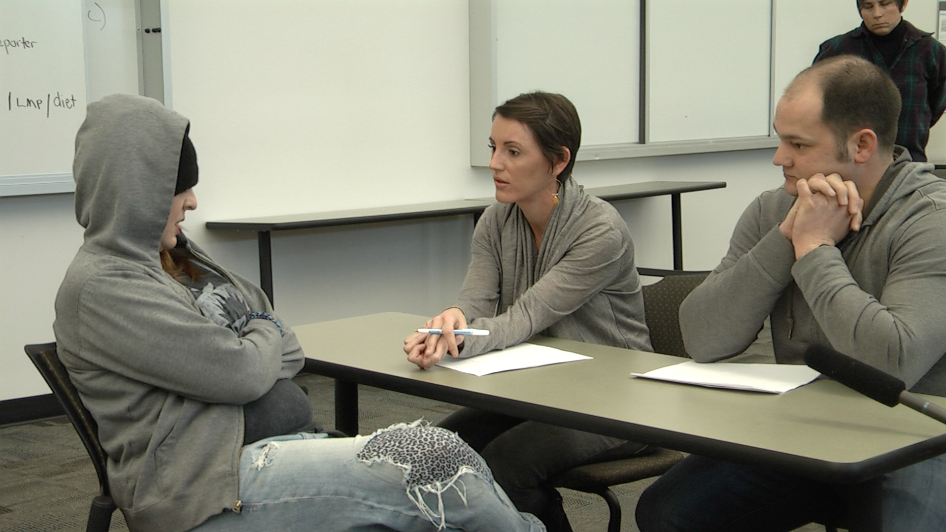 Students speak to an actor as a sullen teen