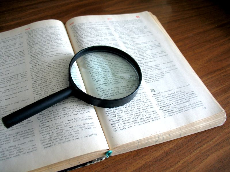 magnifying glass sitting on a book
